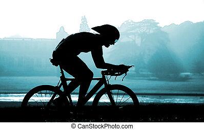 Cyclist against rural backdrop