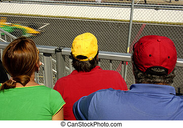 Race Fans - Fans in the Granstand at a Car Race Track