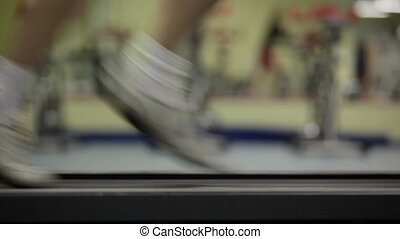 Race track - Blurred video of female legs running on the...