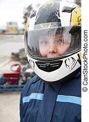 racer in protective helmet