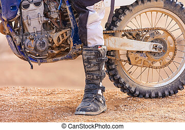 racer on a motorcycle in the desert