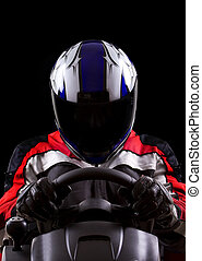 Racer wearing a helmet and protective gear
