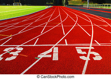 Racetrack - Lanes of a red race track with numbers and green...