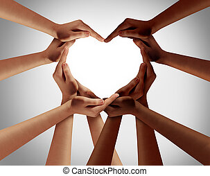 Racial love with white caucasion and black african american hands shaped as an interracial heart representing world unity and ethnic tolerance as a symbol of diversity and equal rights.