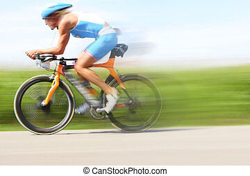 Racing bicycle, motion blur - A bicyclist in a race through ...