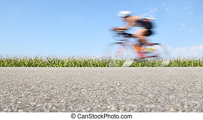 Racing bicycle, motion blur - a motion blurred bicyclist...