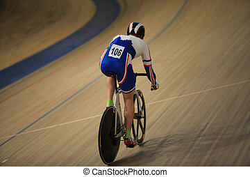 racing Bicycle - cyclist on a racing bike in Velodrome