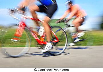 Racing bicycles, motion blur - Two bicyclists in a race...