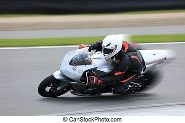 Racing bike rider on the race track