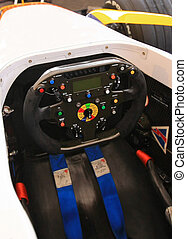 Racing car streeing wheel - Drivers view of a racing car...