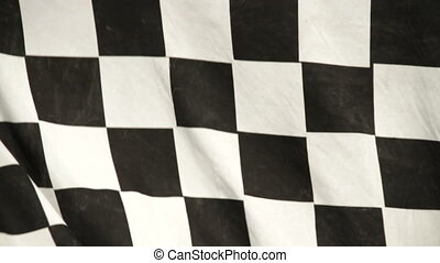 Racing checkered flag in the wind