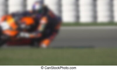 Racing circuit blur with 2 motorcycles in slow-mo, loopable...