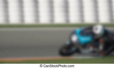 Racing circuit blurred motorcycle in curve and slow-mo -...