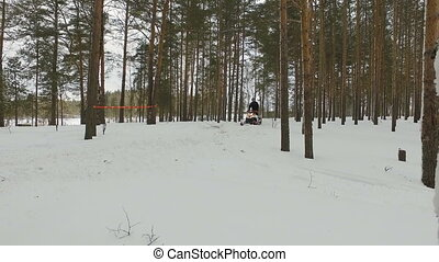 Racing on a snowmobile.