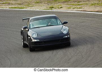 racing on circuit - fast car driving on circuit
