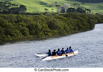 Racing outrigger canoes - TAIPA,NZ - MAY 18:Crew of a racing...