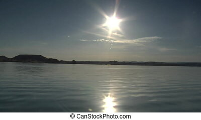racing overwater with Sun and reflections