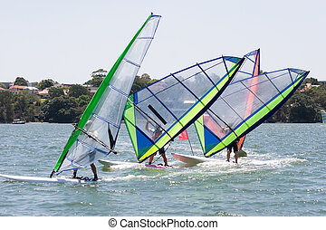 Racing Sailboards - Sailboarders turning the mark