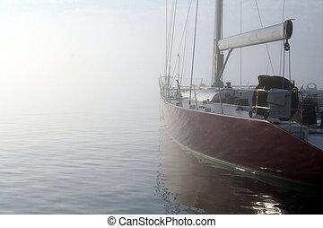 Racing Sailboat - Racing sailboat on a foggy summer morning.