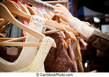 Rack of dresses at market - A rack of second-hand women ...