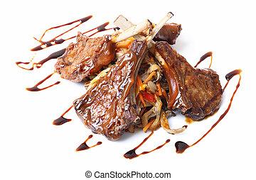 Rack of lamb closeup - Rack of lamb with sauces and garnish...