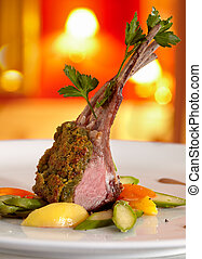 Rack of lamb in a herb crust, served with ratatouille and Portwine sauce