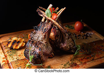 Rack of lamb on a wooden board