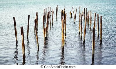 Rack pier posts rusty metal in the sea