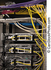 Rack rear II - The rear of a server rack populated with ...