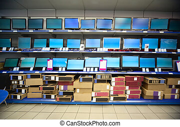 Rack with liquid crystal displays and monitors in...