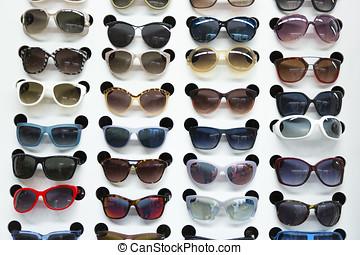 rack with sunglasses in eyewear store