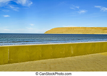 Landscape scene of empty beach located at atlantic coast in Chubut, Argentina