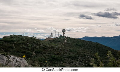 Radar and antenna over mountain time-lapse,