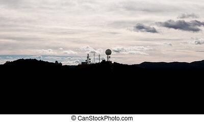 Radar and antenna over mountain time-lapse