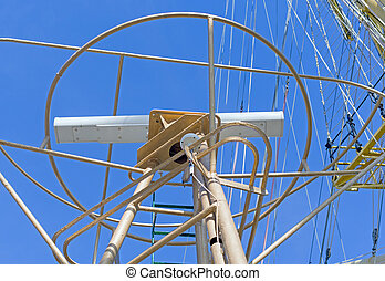 radar on the mast of ship