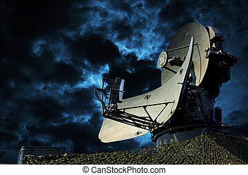 Radar - Air defense radar over dramatic night sky.
