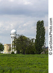 radar tower with poplar tree on airport tempelhofer field, berlin.