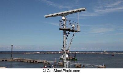 Radar tower with spinning antenna - Radar tower long shot of...