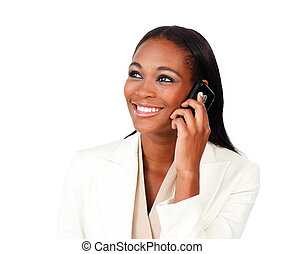 Radiant Afro-american businesswoman on phone against a white...