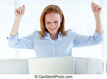 Radiant business woman punching the air
