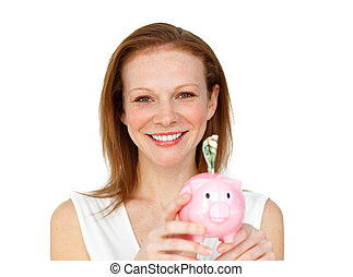 Radiant businesswoman holding a piggybank