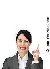 Radiant businesswoman pointing at a copyspace
