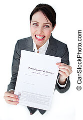 Radiant businesswoman showing a legal document against a white background