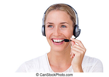 Radiant busineswoman talking on a headset against a white background