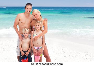 Radiant family on the beach
