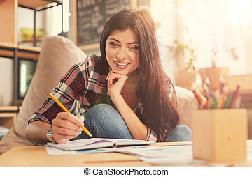 Radiant girl in casual working from home - Comfortable...