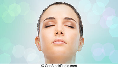 Beautiful young woman portrait with clean flawless skin and eyes closed