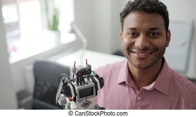 Radiant man posing with his robot