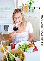 Radiant woman having dinner