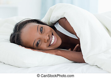 Radiant woman waking up
